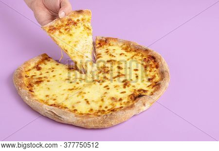Serving A Slice Of Cheese Pizza With Melted Mozzarella On Purple Background. Woman Grabbing Pizza Sl