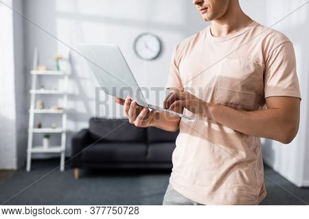 Cropped View Of Man Using Laptop At Home, Earning Online Concept