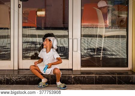 Havana / Cuba - 04.15.2015: Cute Afro Cuban Kid Playing On The Street, Laughing And Having Fun While