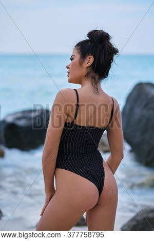 girl on the beach in a swimsuit