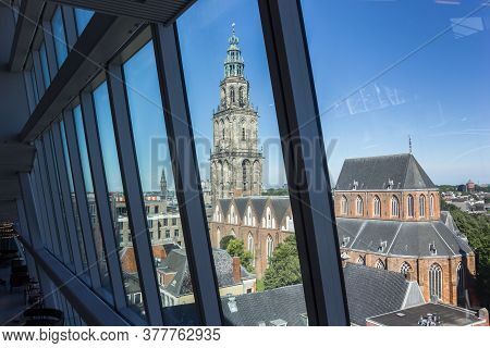 Groningen, Netherlands - July 13, 2020: Tower Of The Historic Martini Church Through The Windows Of