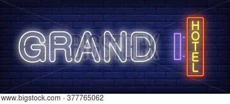 Grand Hotel Neon Sign. Hotel Signboard On Brick Wall Background. Illustration In Neon Style For Hote