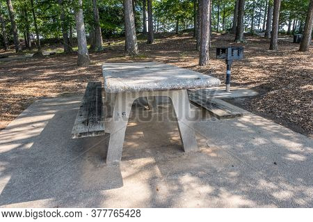 Empty Picnic Table And Grill In The Shade Unused And Clean Sitting On A Cement Pad In The Woodlands
