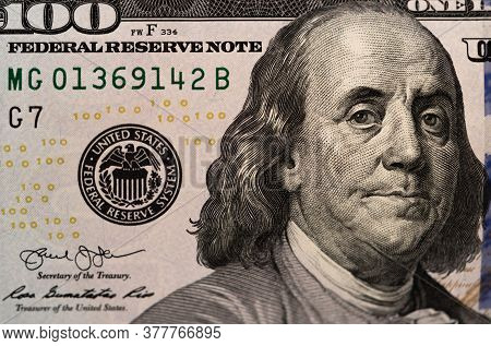 One Hundred Dollars And One Dollar Bills. Closeup Of Benjamin Franklin . Us Dollars Background. Amer