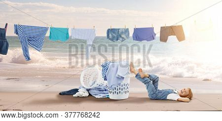 Happy little girl with washed clothes