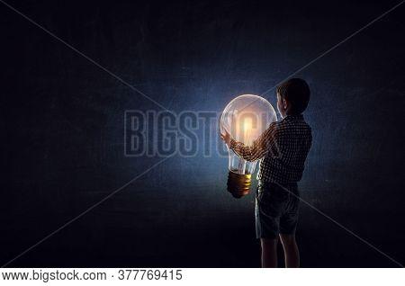 Boy with a light bulb