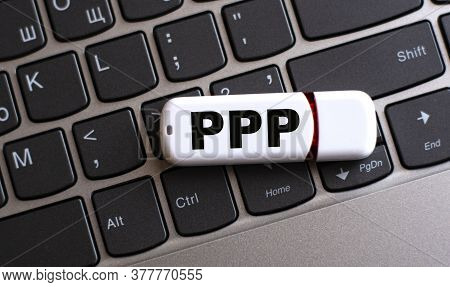 Ppp - The Word On A White Flash Drive, Lying On A Black Laptop Keyboard