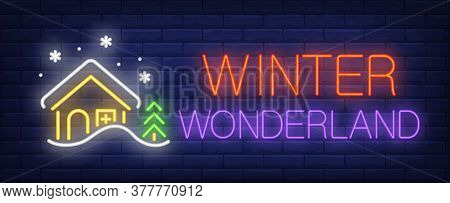 Winter Wonderland Neon Sign. Glowing Inscription With Winter House, Snow And Fir Tree On Brick Wall