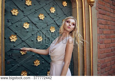 The Princess Enters Her Room In The Castle. A Gorgeous Blonde On The Background Of The Door Looks In