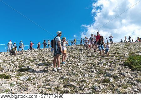 Ai-petri, Crimea - July 5, 2019. Tourists Climb To The Mountaintop, Landmark