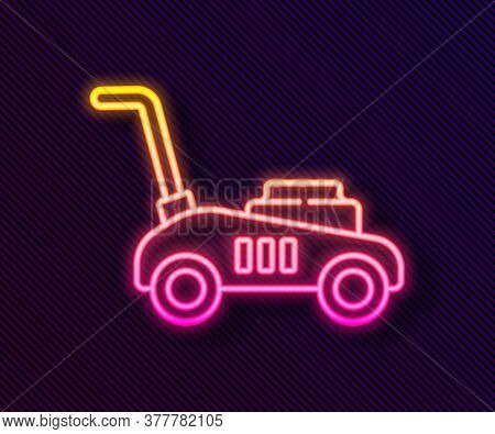 Glowing Neon Line Lawn Mower Icon Isolated On Black Background. Lawn Mower Cutting Grass. Vector Ill