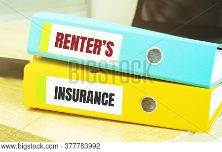 Two Office Folders With Text Renters Insurance