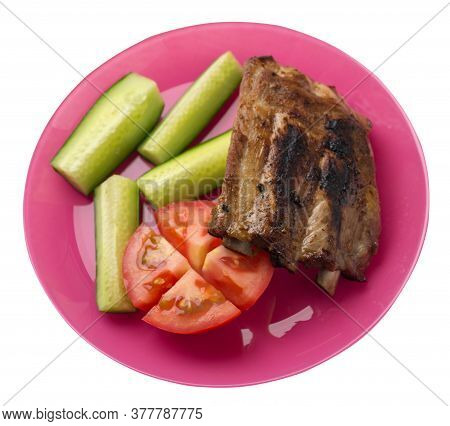 Grilled Pork Ribs With Sliced Cucumbers And Tomatoes On A Plate. Pork Ribs Isolated On White Backgro