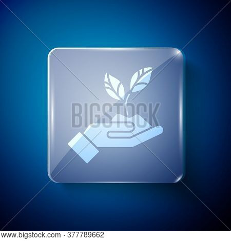 White Plant In Hand Of Environmental Protection Icon Isolated On Blue Background. Seed And Seedling.