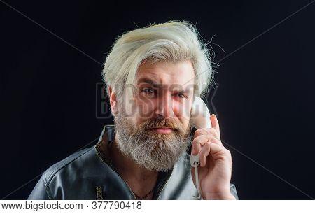 Communication. Bearded Man With Handset. Male Talking On Landline Phone. Serious Man Talking On Retr