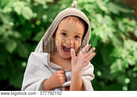 Smiling Toddler Boy Wrapped In Big Bathing Towel After Swimming In Outdoor Pool. Happily Laughing Ch