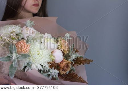 Portrait Of Long-haired Brunette Girl With Beautiful Summer Bouquet, Gift Or Congratulation Concept,