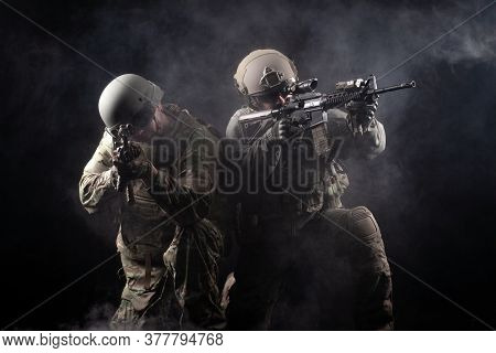 Two Soldiers In Military Uniform With Weapons In A Special Operation At Night, Special Forces Attack