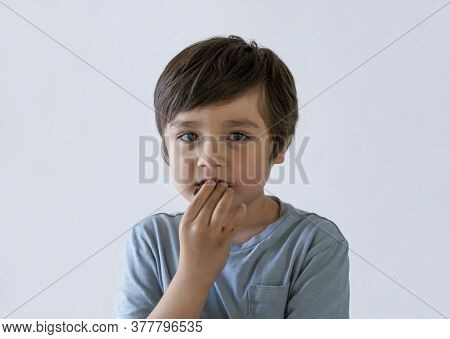 Hungry Kid Eating Chocolate Cake, Happy Child Looking At Camera While Eating Sweet For His Snack, Is