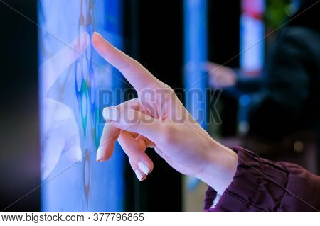 Woman Hand Using Touchscreen Display Of Electronic Kiosk With Interactive City Map At Street Or Tran