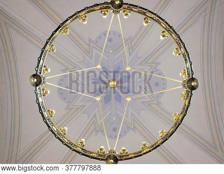 Beautiful Chandelier Against The Background Of The Church Vault, Conceptual Background For Themes On