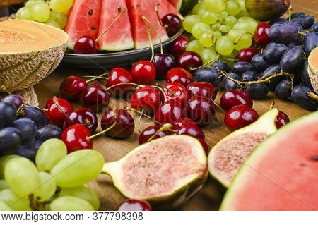 Different Fruits On A Wooden Background. The Concept Of Harvest And Italian Winemaking. 15 Agusta Fe