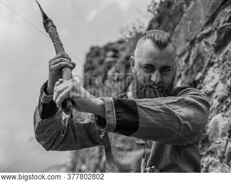Viking Warrior With Thick Beard Brandishes An Ax