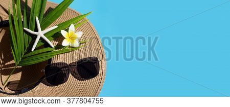 Summer Hat With Sunglasses On Blue Background. Enjoy Holiday Concept. Copy Space