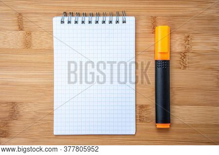 White Notebook For Notes, Highlighter Marker Pen And Wooden Background.top View Copy Space, 2020 Goa