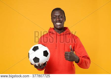 Smiling Young African American Man Guy Football Player In Red Streetwear Hoodie Isolated On Yellow W