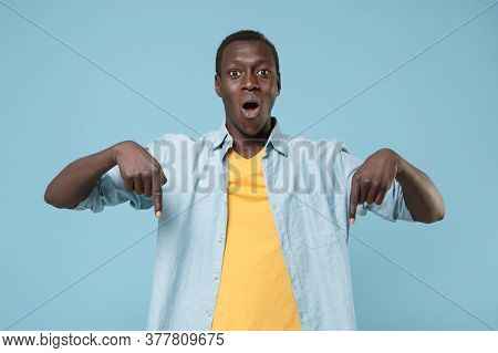 Shocked Young African American Man Guy In Casual Shirt, Yellow T-shirt Posing Isolated On Blue Backg