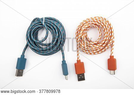 Two Rolled C Cable Usb Cable Over White Background