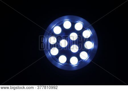 Head On View Of A Lit Led Flashlight