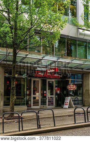 Vancouver, Canada - June 10, 2020: Tim Hortons, A Canadian Multinational Fast Food Restaurant In Rai