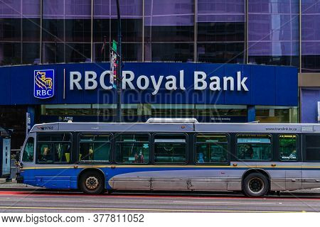 Vancouver, Canada - June 10, 2020: Public Transit Bus In Front Of Rbc Royal Bank In Downtown Vancouv