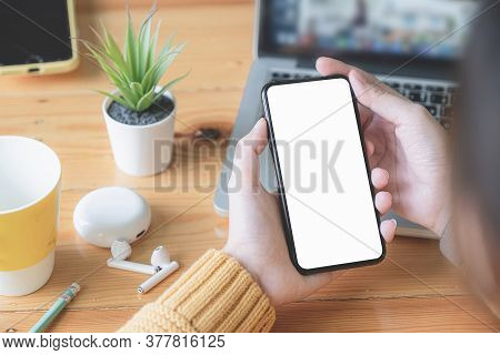 Asian Woman Holding Smartphone With Blank Screen Frameless Modern Design. Technology Concept.