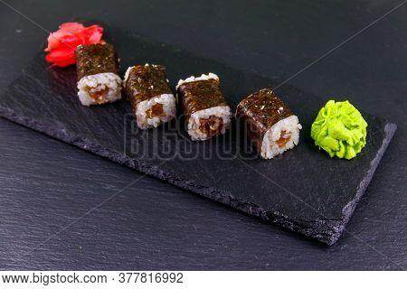 Sushi Maki Rolls With Tuna On Black Slate
