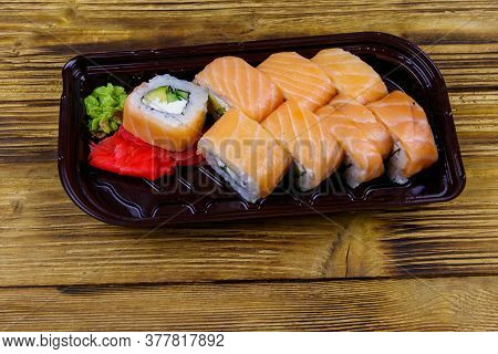 Sushi Rolls Philadelphia In Plastic Box On Wooden Table. Sushi For Take Away Or Delivery Of Sushi In