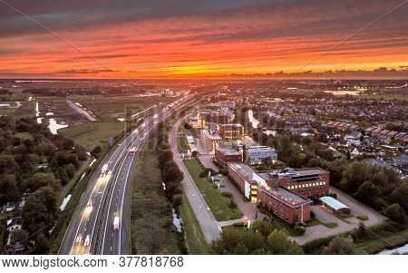 Aerial View Over Motorway A7 Entry Point On The West Side Of Groningen City Under Orange Sunset. Net