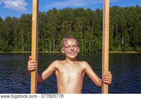 Smiling Caucasian Child Going To Swim In Cold Lake On Summer Sunny Day. 10 Years Old Boy Going Down