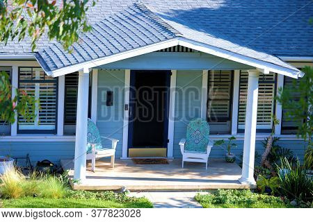 Front Porch With Chairs At A Middle Class Ranch Home In A Residential Neighborhood