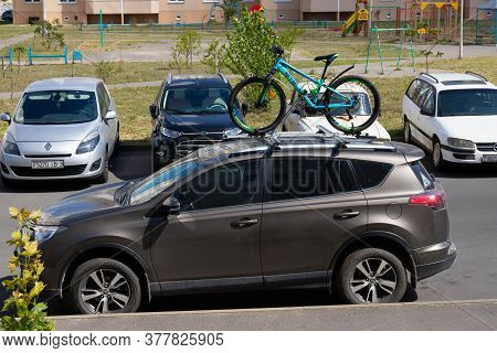 Gomel, Belarus - July 18 2020: The Children Bike Is Installed On The Trunk Of The Car. Car Raiding C