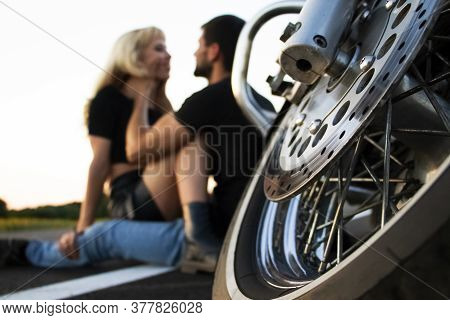 Bikers Man And Woman Stopped At The Side Of The Road To Rest And Kiss Passionately. Photos Of Loving