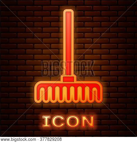 Glowing Neon Garden Rake Icon Isolated On Brick Wall Background. Tool For Horticulture, Agriculture,