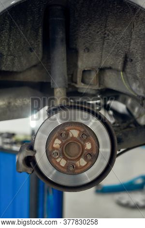 Close Up Of Braking Disc Of The Vehicle With Brake Caliper For Repair In Process Of New Tire Replace