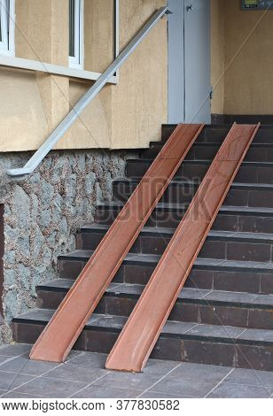 Metal Ramp On Concrete Porch For People With Disabilities