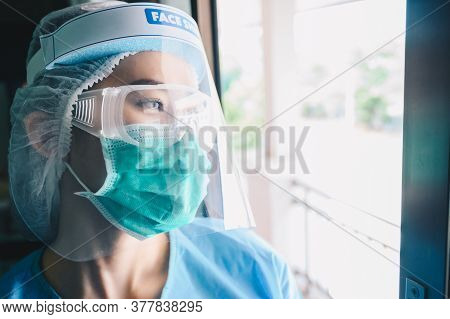 Nurse Having Tired From Work While Wearing Ppe Suit For Protect Coronavirus Disease. Ppe While Prote