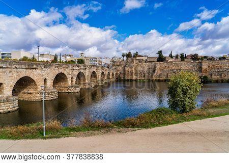 Merida, Spain - November 05, 2019: Puente Romano, The Roman Bridge In Merida. It Is The Longest Surv