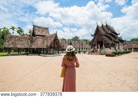 Back View Of Female Tourist Visiting The Beautiful Architecture Of Wat Inthrawat Temple Is One Of Th