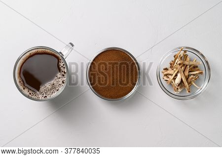 A Healthy Drink, An Alternative To Coffee. Chicory Drink In A Glass Cup, Dried Roots And Powder In B